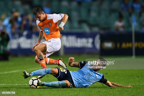 Eric Bautheac of Brisbane is tackled Milos Ninkovic of Sydney during the round 23 ALeague match between Sydney FC and the Brisbane Roar at Allianz...