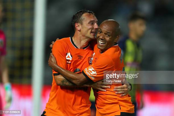 Eric Bautheac of Brisbane Roar and team mate Henrique celebrate a goal during the Round 20 ALeague Match between the Central Coast Mariners and...