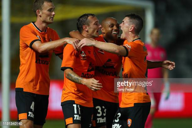 Eric Bautheac of Brisbane Roar and team mate Henrique celebrate a goal with fellow Roar players during the Round 20 ALeague Match between the Central...