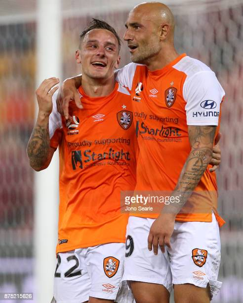 Eric Bautheac of Brisbane Roar celebrates his goal with team mate Massimo Maccarone during the round seven ALeague match between Brisbane Roar and...