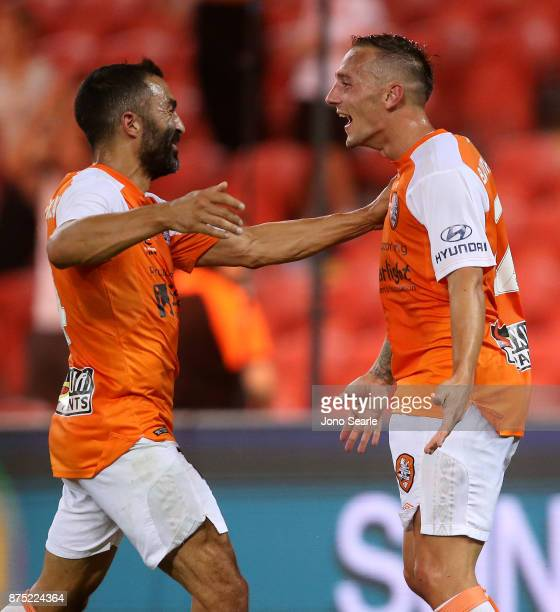 Eric Bautheac of Brisbane Roar celebrates his goal with team mate Fahid Ben Khalfallah during the round seven ALeague match between Brisbane Roar and...
