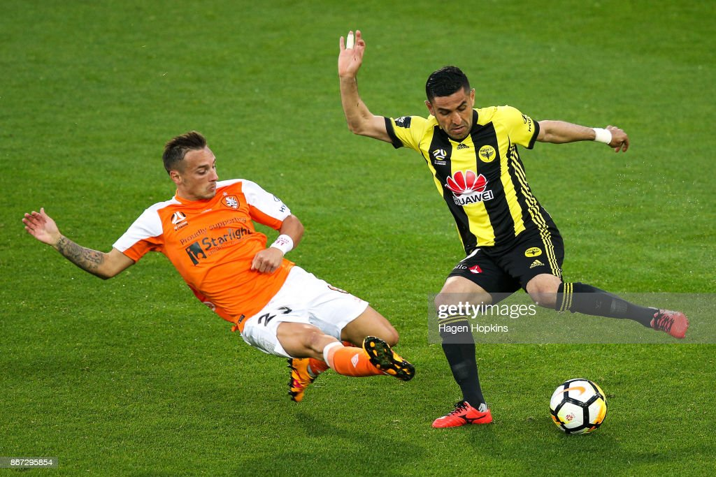 Eric Bautheac of Brisbane tackles Ali Abbas of the Phoenix during the round four A-League match between the Wellington Phoenix and the Brisbane Roar at Westpac Stadium on October 28, 2017 in Wellington, New Zealand.