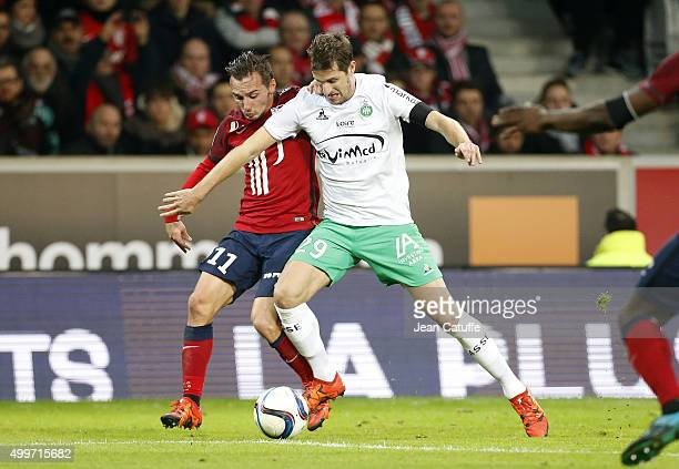 Eric Bautheac of Lille and Francois Clerc of SaintEtienne in action during the French Ligue 1 match between Lille OSC and AS SaintEtienne at Stade...