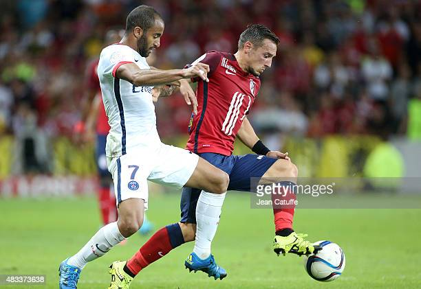 Eric Bautheac of Lille and Lucas Moura of PSG in action during the French Ligue 1 match between Lille OSC and Paris SaintGermain at Grand Stade...