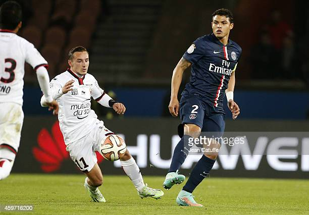 Eric Bautheac of Nice and Thiago Silva of PSG in action during the French Ligue 1 match between Paris SaintGermain FC and OGC Nice at Parc des...