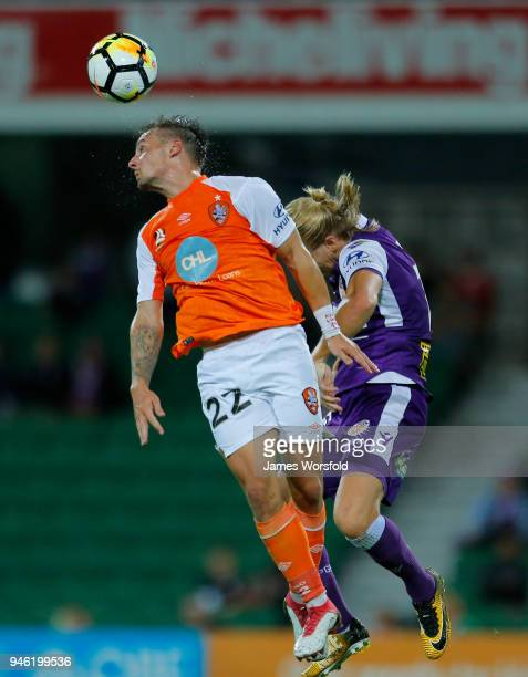 Eric Bautheac of the Brisbane Roar and Joseph Mills of the Perth Glory go up for the header during the round 27 ALeague match between the Perth Glory...