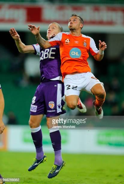 Eric Bautheac of the Brisbane Roar and Shane Lowry of the Perth Glory go up for header contest during the round 27 ALeague match between the Perth...