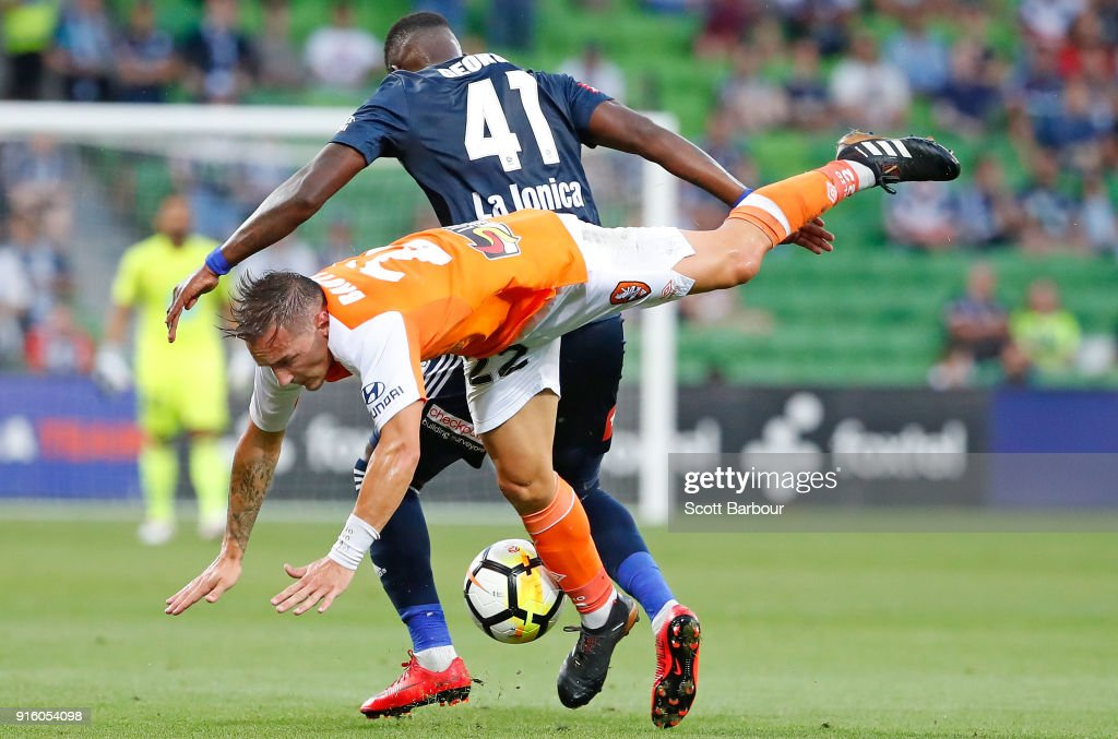 Eric Bautheac of the Roar and Leroy George of the Victory compete for the ball during the round 20 A-League match between the Melbourne Victory and the Brisbane Roar at AAMI Park on February 9, 2018 in Melbourne, Australia.