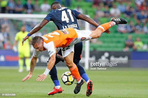 Eric Bautheac of the Roar and Leroy George of the Victory compete for the ball during the round 20 ALeague match between the Melbourne Victory and...