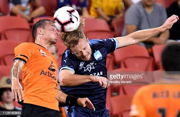 Eric Bautheac of the Roar and Rhyan Grant of Sydney challenge for the ball during the round 18 ALeague match between the Brisbane Roar and Sydney FC...