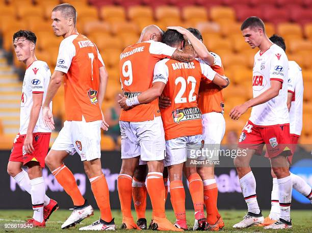 Eric Bautheac of the Roar celebrates with team mates after scoring a goal during the round 22 ALeague match between the Brisbane Roar and Adelaide...