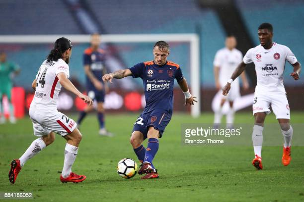 Eric Bautheac of the Roar passes the ball to a team mate during the round nine ALeague match between the Western Sydney Wanderers and the Brisbane...