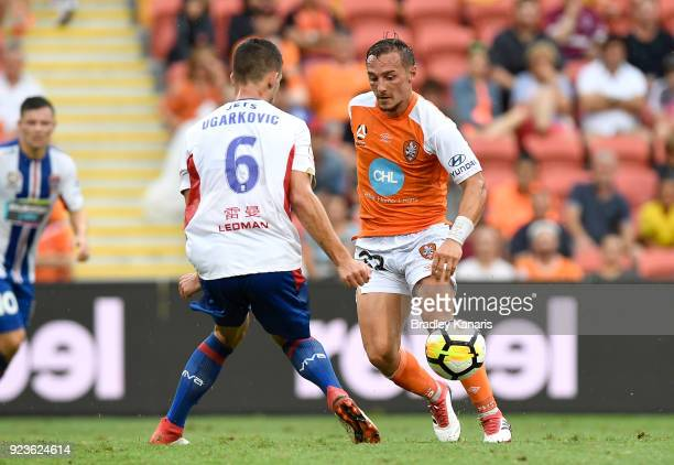 Eric Bautheac of the Roar takes on the defence during the round 21 ALeague match between the Brisbane Roar and the Newcastle Jets at Suncorp Stadium...