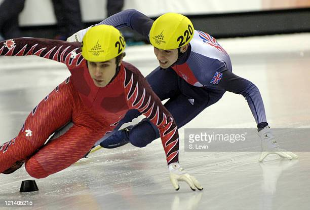 Eric Bedard of Canada and Jon Eley of Great Britan during the Men's 500 m in the 2006 Winter Olympic Games at the Palavela in Torino Italy on...