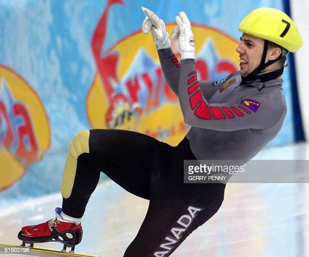Eric Bedard of Canada celebrates 11 March 2000 after winning the Mens 500m final of the World Short Track Speed Skating Championships at the...
