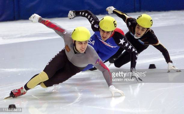 Eric Bedard of Canada takes the lead from Daniel Weinstein of the US and Satoru Terao of Japan 11 March 2000 and go on to win the men's 500m final...