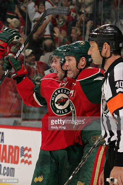 Eric Belanger celebrates with his Minnesota Wild teammate Owen Nolan after scoring a goal against the Anaheim Ducks during the game at the Xcel...