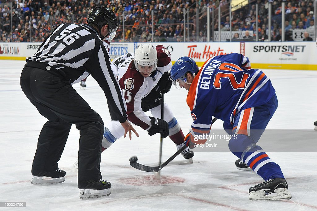 Eric Belanger #20 of the Edmonton Oilers takes a face off against PA Parenteau #15 of the Colorado Avalanche at Rexall Place on January 28, 2013 in Edmonton, Alberta, Canada.