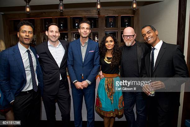 Eric Benet and Manuela Testolini pose with guest at the 'In A Perfect World Give 100 Fundraiser' at The District Restaurant on November 17 2016 in...