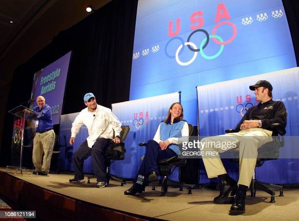 Eric Bergoust with US freestyle skiing teammates Emily Cook and Joe Pack joke with the media during a press conferance at the US Olympic Media Summit...