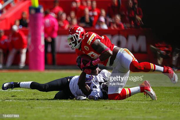Eric Berry of the Kansas City Chiefs pulls the ball away Lardarius Webb of the Baltimore Ravens in the third quarter on October 07, 2012 at Arrowhead...