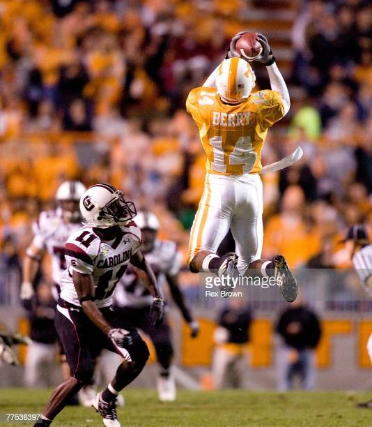 Eric Berry of the Tennessee Volunteers pulls down this interception intended for Kenny McKinley of the South Carolina Gamecocks during the first half...