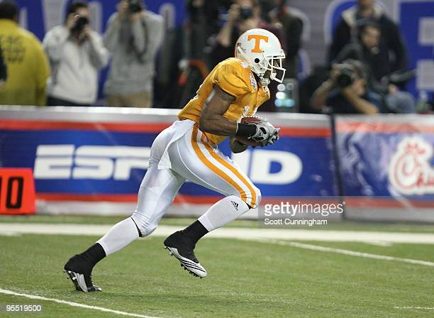 Eric Berry of the Tennessee Volunteers returns a kick during the ChickFilA Bowl game against the Virginia Tech Hokies at the Georgia Dome on December...