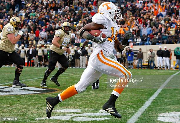 Eric Berry of the Tennessee Volunteers returns an interception for a touchdown against the Vanderbilt Commodores during the game at Vanderbilt...