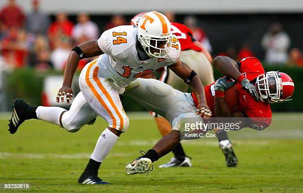 Eric Berry of the Tennessee Volunteers tackles Knowshon Moreno of the Georgia Bulldogs during the game at Sanford Stadium on October 11 2008 in...