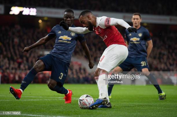 Eric Bertrand Bailly of Manchester United and Alexandre Lacazette of Arsenal during the FA Cup Fourth Round match between Arsenal and Manchester...