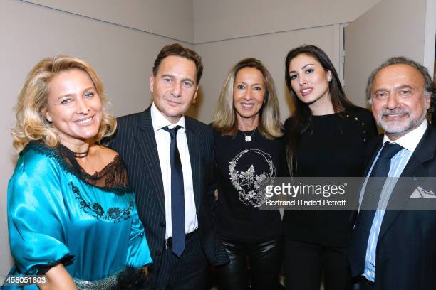 Eric Besson and his wife Yasmine Besson Olivier Dassault and his wife Natacha Dassault and producer of the show Nicole Coullier pose backstage...