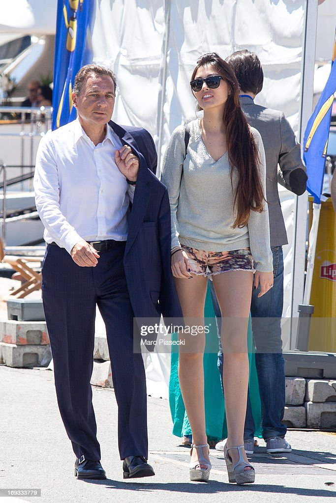 Eric Besson and yasmine Tordjman are seen strolling in the Cannes harbour during the 66th annual Cannes Film Festival on May 23, 2013 in Cannes, France.