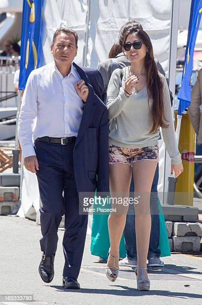 Eric Besson and yasmine Tordjman are seen strolling in the Cannes harbour during the 66th annual Cannes Film Festival on May 23 2013 in Cannes France