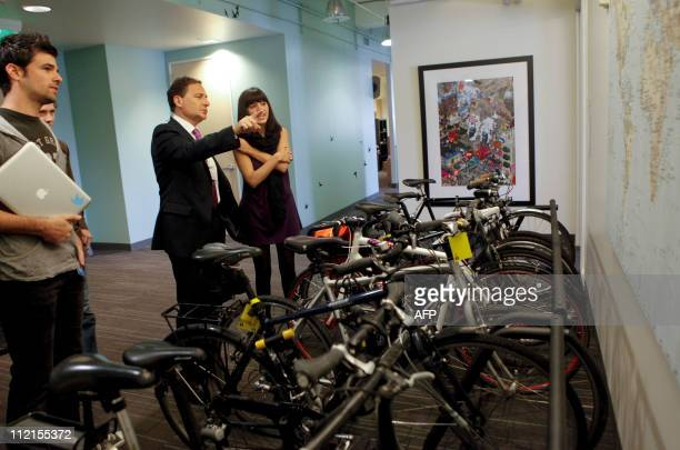Eric Besson French Minister for Industry Energy and Digital Economy speaks with Laura Gomez Twitter's manager for international user services while...