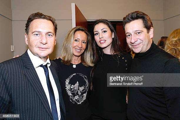Eric Besson with his wife Yasmine Besson producer of the show Nicole Coullier and Laurent Gerra pose backstage following the show of impersonator...