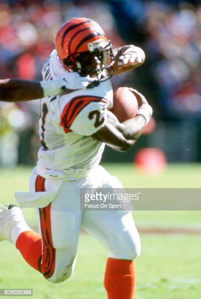 Eric Biemiemy of the Cincinnati Bengals carries the ball against the San Francisco 49ers during an NFL football game October 20 1996 at Candlestick...