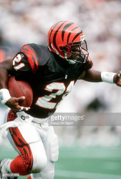 Eric Bieniemy of the Cincinnati Bengals carries the ball against the Jacksonville Jaguars during an NFL football game October 27 1996 at Riverfront...