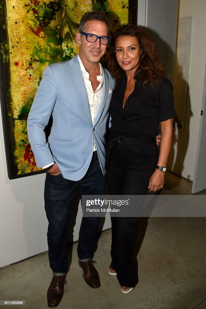 Eric Bland and Valeria Vigas attend IV New York Gallery Grand Opening Exhibition on September 14, 2017 in New York City.