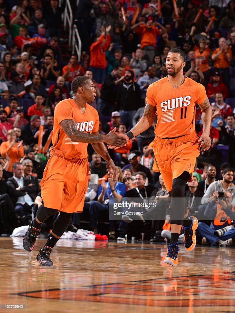 Eric Bledsoe #2 and Markieff Morris #11 of the Phoenix Suns celebrate during a game against the Chicago Bulls on January 30, 2015 at U.S. Airways Center in Phoenix, Arizona.