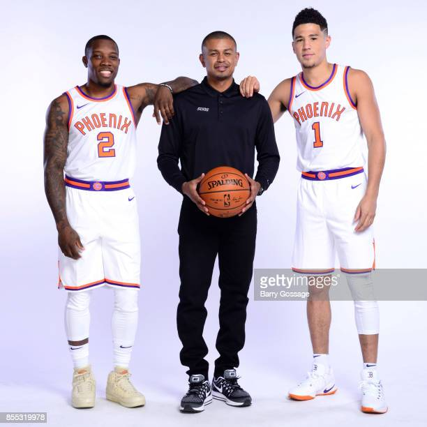 Eric Bledsoe Head Coach Earl Watson Devin Booker of the Phoenix Suns pose for a portrait at the Talking Stick Resort Arena in Phoenix Arizona NOTE TO...