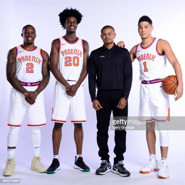 Eric Bledsoe Josh Jackson Head Coach Earl Watson and Devin Booker of the Phoenix Suns pose for a portrait at the Talking Stick Resort Arena in...