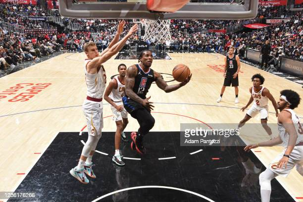 Eric Bledsoe of the LA Clippers drives to the basket against the Cleveland Cavaliers on October 27, 2021 at STAPLES Center in Los Angeles,...