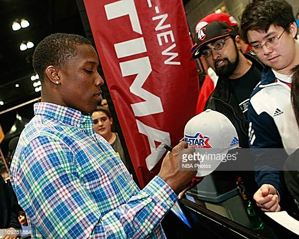 Eric Bledsoe of the LA Clippers signs autographs for fans during a suprise apperance in the Kia MVP Court at Jam Session presented by Adidas during...
