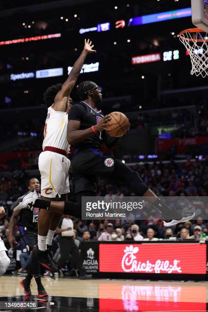 Eric Bledsoe of the LA Clippers takes a shot against Collin Sexton of the Cleveland Cavaliers in the third quarter at Staples Center on October 27,...