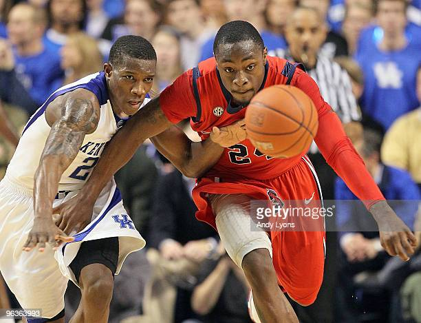 Eric Bledsoe of the Kentucky Wildcats and Terrico White of the Ole Miss Rebels reach for a loose ball during the SEC game on February 2, 2010 at Rupp...