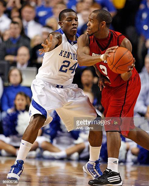 Eric Bledsoe of the Kentucky Wildcats defends Preston Knowles of the Louisville Cardinals at Rupp Arena on January 2 2010 in Lexington Kentucky...