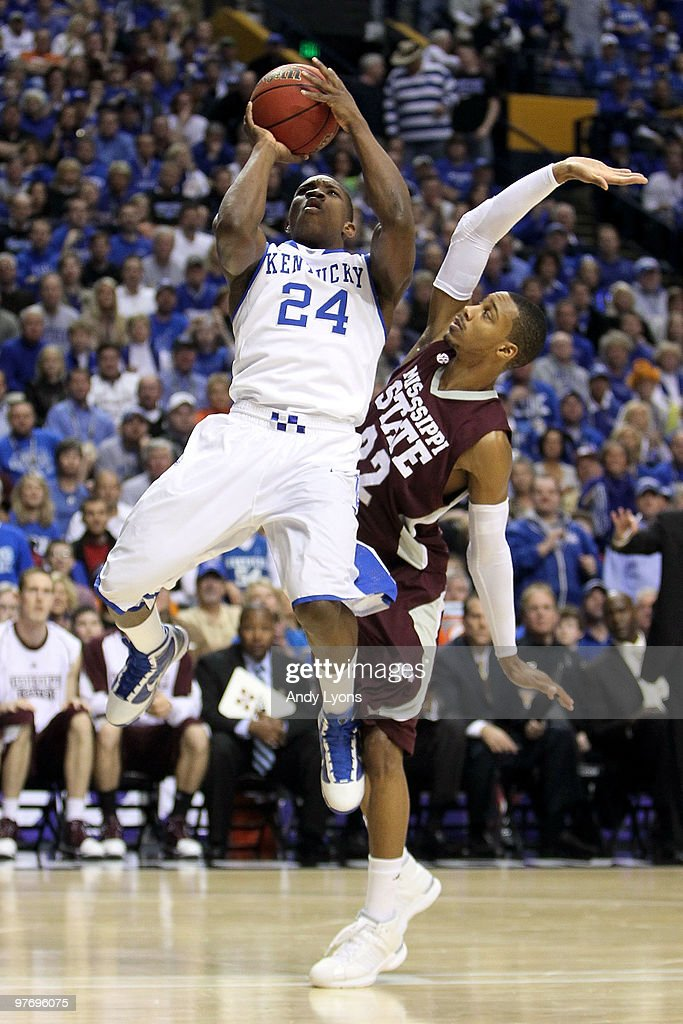 Eric Bledsoe #24 of the Kentucky Wildcats drives for a shot attempt against Barry Stewart #22 of the Mississippi State Bulldogs during the final of the SEC Men's Basketball Tournament at the Bridgestone Arena on March 14, 2010 in Nashville, Tennessee.