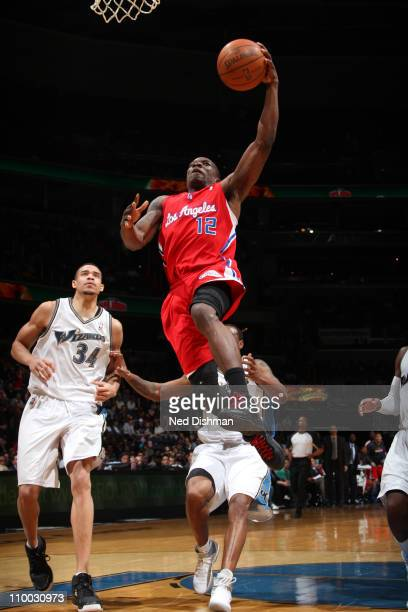 Eric Bledsoe of the Los Angeles Clippers dunks over the Washington Wizards at the Verizon Center on March 12 2011 in Washington DC NOTE TO USER User...