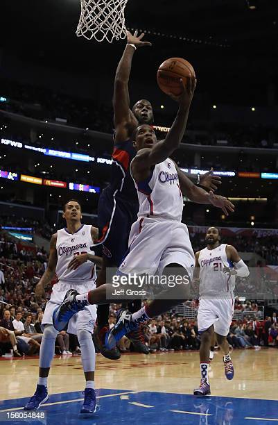 Eric Bledsoe of the Los Angeles Clippers goes up for a layup while being pursued by Ivan Johnson of the Atlanta Hawks in the second half at Staples...