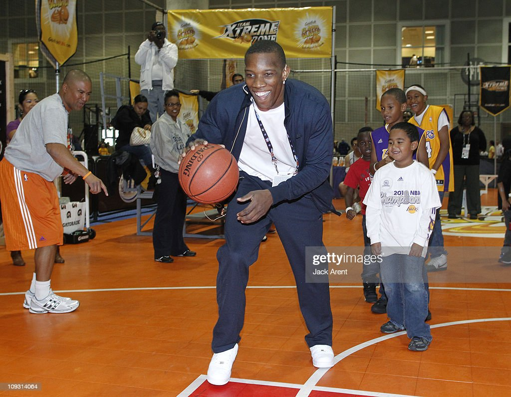 Eric Bledsoe of the Los Angeles Clippers participates in drills along with the kids on the Goldfish court during Jam Session presented by Adidas during All Star Weekend on February 20, 2011 in Los Angeles, California.